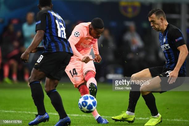 Malcom of Barcelona scores his side's first goal during the Group B match of the UEFA Champions League between FC Internazionale and FC Barcelona at...