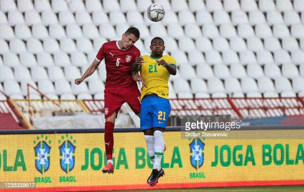 Malcom of Brazil jumps for the ball against Damjan Danicic of Serbia during the International football friendly match between Serbia U21 and Brazil...