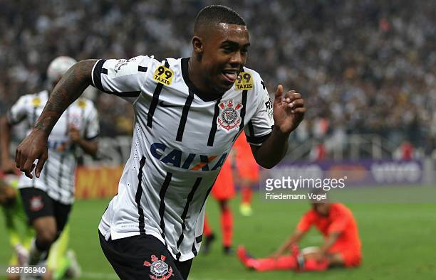 Malcom of Corinthians celebrates scoring the third goal during the match between Corinthians and Sport Recife for the Brazilian Series A 2015 at...