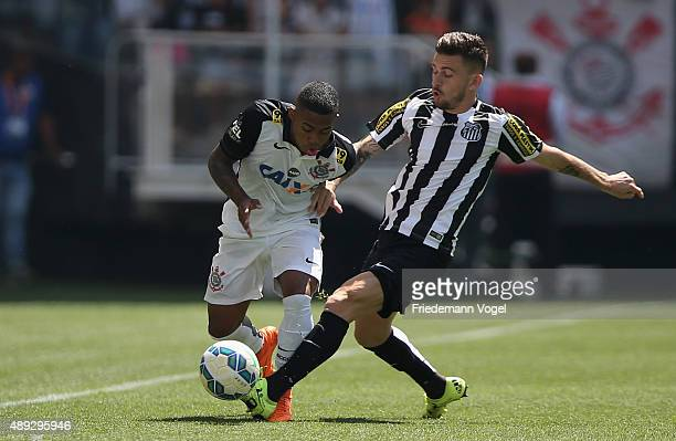 Malcom of Corinthians fights for the ball with Lucas Lima of Santos during the match between Corinthians and Santos for the Brazilian Series A 2015...