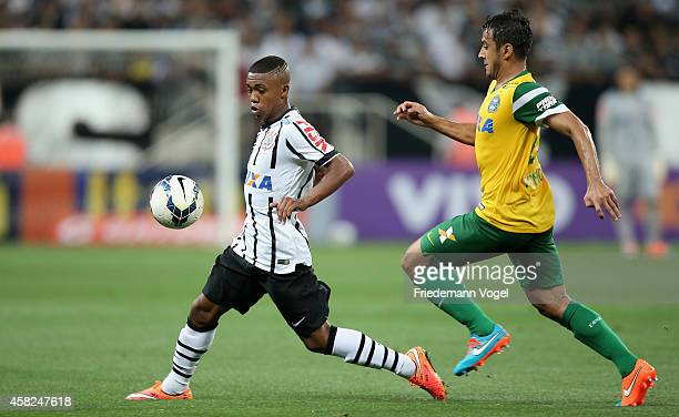 Malcom of Corinthians fights for the ball with Robinho of Coritiba during the match between Corinthians and Coritiba for the Brazilian Series A 2014...