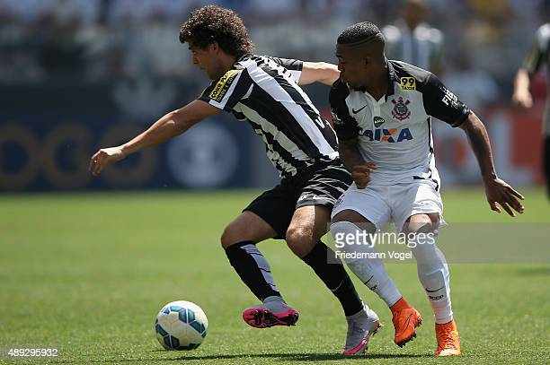 Malcom of Corinthians fights for the ball with Victor Ferraz of Santos during the match between Corinthians and Santos for the Brazilian Series A...
