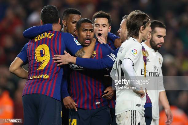 Malcom of FC Barcelona celebrates with his team mates after scoring his team's first goal during the Copa del Semi Final first leg match between...