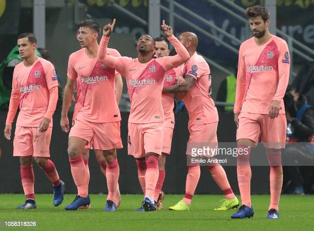 Malcom of FC Barcelona celebrates with his teammates after scoring the opening goal during the Group B match of the UEFA Champions League between FC...