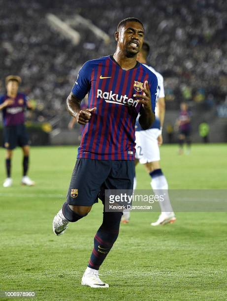 Malcom of FC Barcelona reacts after his shot on goal was blocked by goalkeeper Michel Vorm of Tottenham Hotspur during the second half of an...