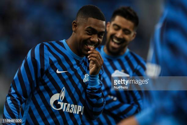 Malcom of FC Zenit Saint Petersburg shares a laughter with Christian Noboa during the warm-up ahead of the Russian Premier League match between FC...