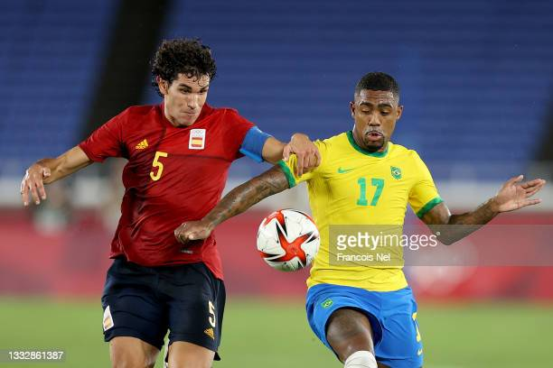 Malcom of Team Brazil battles for possession with Jesus Vallejo of Team Spain during the Men's Gold Medal Match between Brazil and Spain on day...