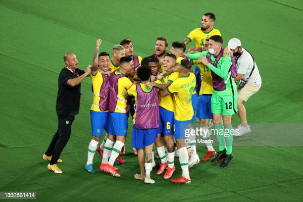 Malcom of Team Brazil celebrates with team mates after scoring their side's second goal during the Men's Gold Medal Match between Brazil and Spain on...