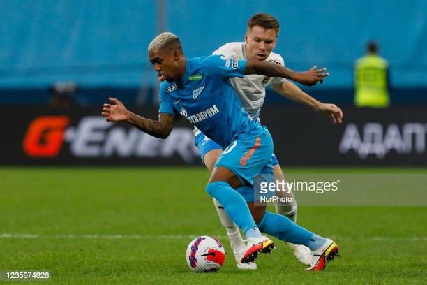 Malcom of Zenit and Sergey Terekhov of Sochi vie for the ball during the Russian Premier League match between FC Zenit Saint Petersburg and FC Sochi...