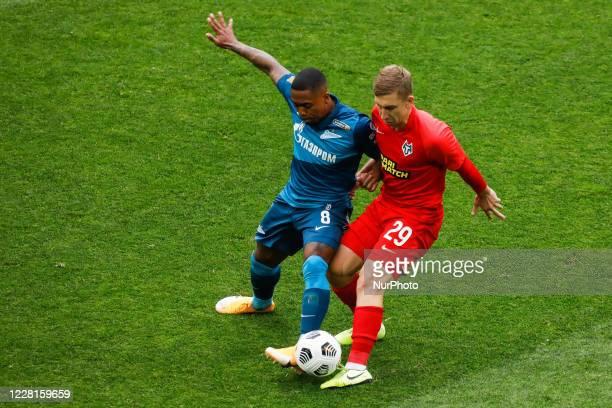 Malcom of Zenit Saint Petersburg and Oleksandr Kapliyenko of Tambov vie for the ball during the Russian Premier League match between FC Zenit Saint...