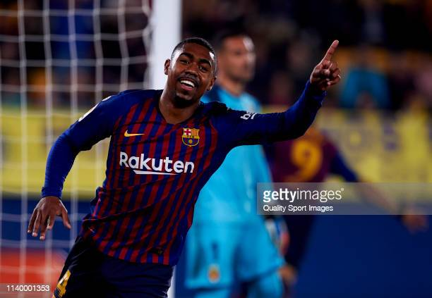 Malcom Oliveira of FC Barcelona celebrates after scoring his team's second goal during the La Liga match between Villarreal CF and FC Barcelona at...
