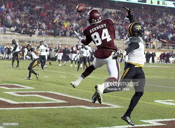 Malcome Kennedy of the Texas AM Aggies catches a touchdown pass while Duron Singleton of the Missouri Tigers covers in the second half of an NCAA...