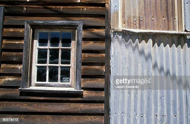 A window in an antique timber and corrugated tin building.