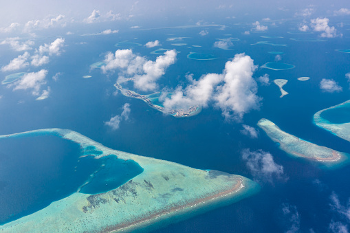 Maldives island aerial view. Atolls and blue lagoon in tropical sea. Drone or airplane view - gettyimageskorea