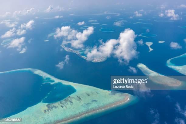 maldives island aerial view. atolls and blue lagoon in tropical sea. drone or airplane view - inquadratura da un aereo foto e immagini stock