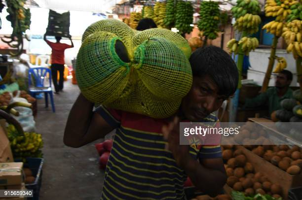 Maldives labourer carries watermelons at a local fruits and vegetables market in Maldives capital Male on February 8 2018 The international community...