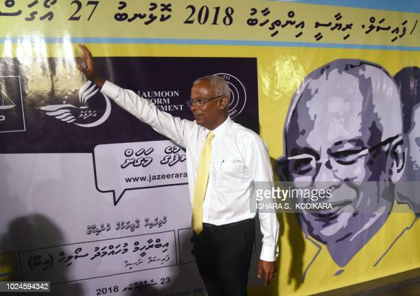 Maldives' main opposition leader and presidential candidate Ibrahim Mohamed Solih waves as he arrives for a meeting at Mount Lavinia a suburb of...