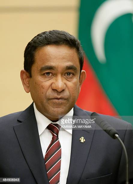 Maldives President Abdulla Yameen Abdul Gayoom speaks during a joint press conference with Japanese Prime Minister Shinzo Abe at the latter's...