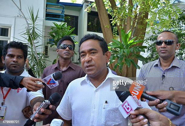 Maldives President Abdulla Yameen Abdul Gayoom talks to journalists on voting day for the parliamentary elections in Male on March 22 2014...