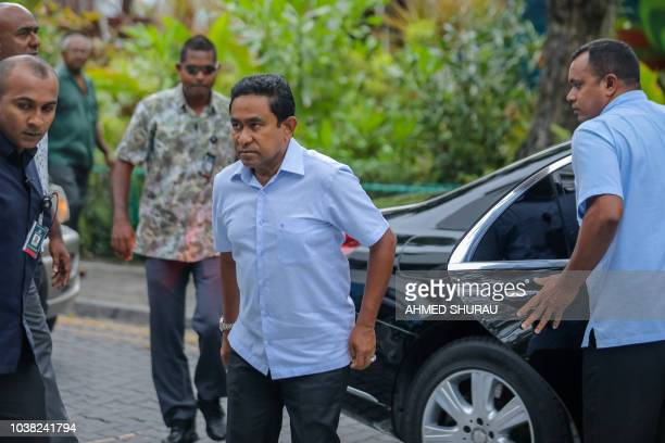 Maldives President Abdulla Yameen arrives at a polling station in the capital Male on September 23 2018 Voting began in a controversial presidential...