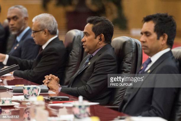 Maldives' President Abdulla Yameen speaks to China's President Xi Jinping during a meeting at the Great Hall of the People in Beijing on December 7...