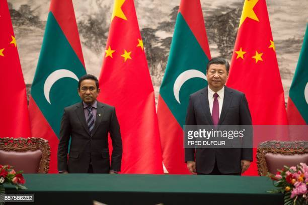 Maldives' President Abdulla Yameen stands with China's President Xi Jinping during a signing ceremony at the Great Hall of the People in Beijing on...