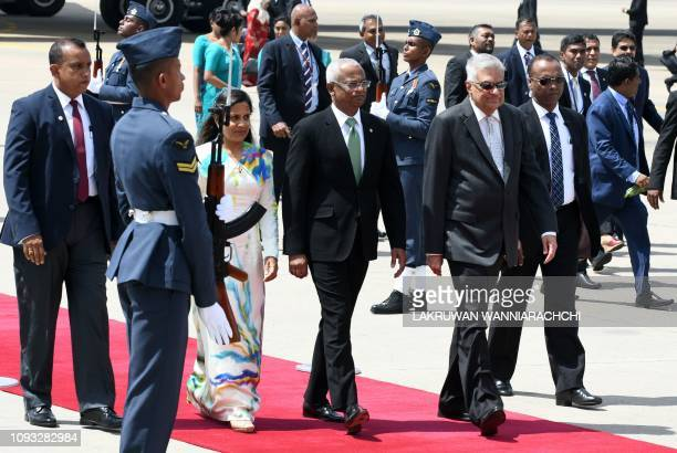 Maldives President Ibrahim Mohamed Solih and his wife Fazna Ahmed walks with Sri Lanka's Prime Minister Ranil Wickremesinghe after their arrival at...