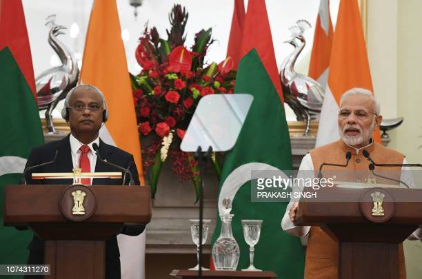 Maldives President Ibrahim Mohamed Solih listens as India Prime Minister Narendra Modi delivers his speech during a ceremony in New Delhi on December...