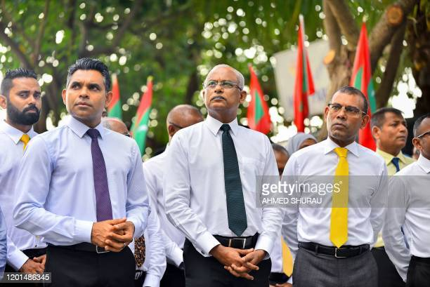 Maldives' President Ibrahim Mohamed Solih looks on next to Vice President Faisal Naseem and former president Mohamed Nasheed during the launch of a...
