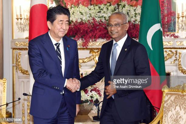 Maldives President Ibrahim Mohamed Solih shakes hands with Japanese Prime Minister Shinzo Abe prior to their meeting at the Akasaka State Guest House...