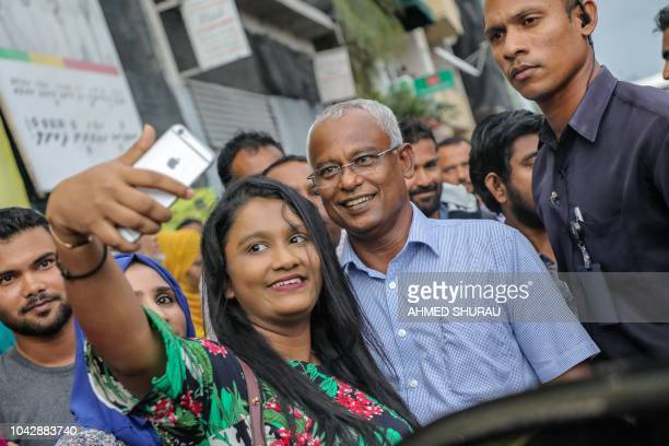 Maldives Presidentelect Ibrahim Mohamed Solih poses for a picture as he participates in celebrations after winning the presidential elections in Male...
