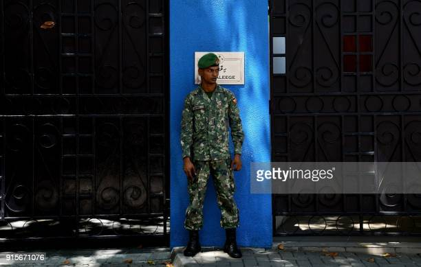 Maldives soldier stands guard outside the president's residence in Male on February 8 2018 The international community has censured Maldives...