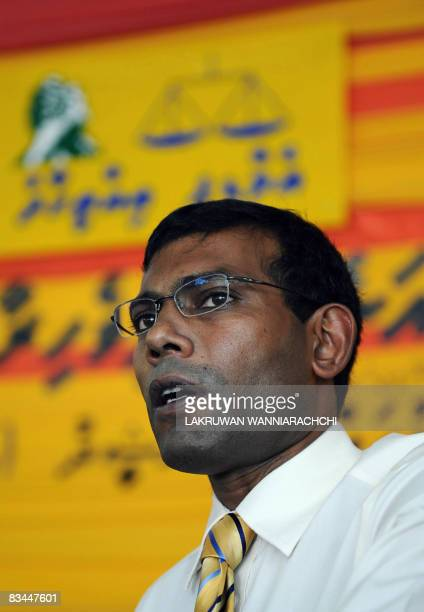 Maldivian Democratic Party's founder and presidential candidate Mohamed 'Anni' Nasheed gestures speaks an interview with AFP in Male on October 27...