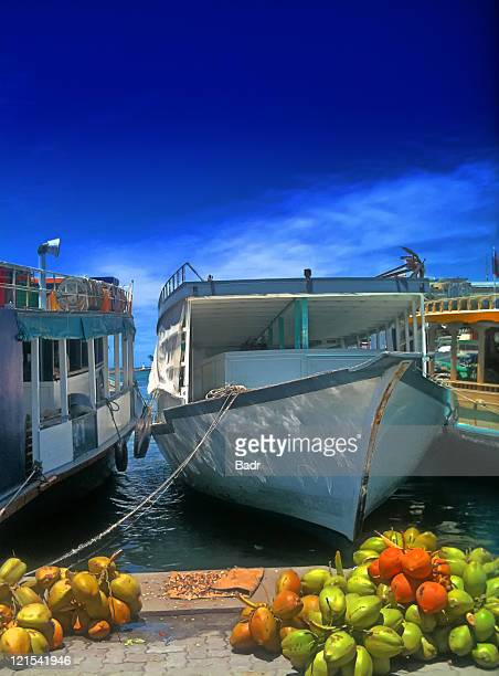 maldivian dhoni - water taxi at male' maldives - male maldives stock pictures, royalty-free photos & images