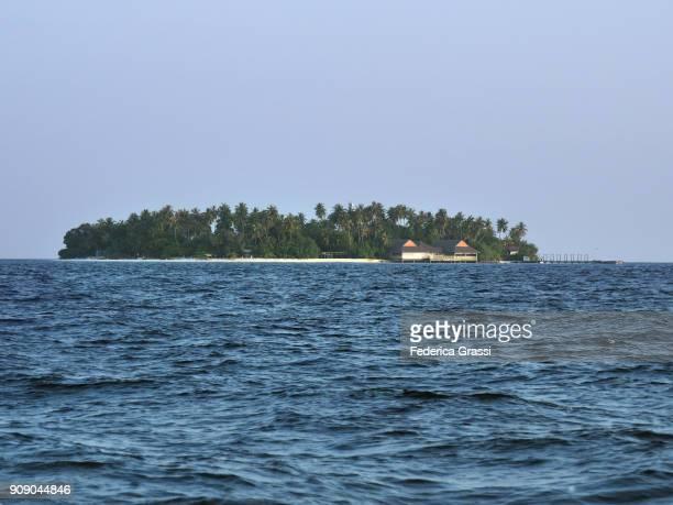 Maldivian Island Kuda Bandos Seen From A Boat