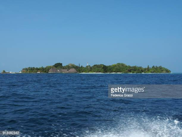 Maldivian Island Of Bandos Seen From A Tourist Boat