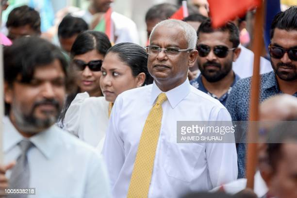Maldivian opposition candidate Ibrahim Solih walks during a march to the Election Commission to submit his application for President along with his...