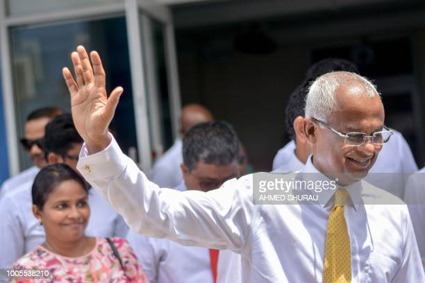 Maldivian opposition candidate Ibrahim Solih waves during a march to the Election Commission to submit his application for President along with his...