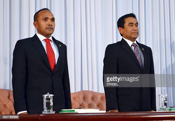 Maldivian President Abdulla Yameen and VicePresident Mohamed Jameel Ahmed stand at attention during their swearing in ceremony in Male on November 17...