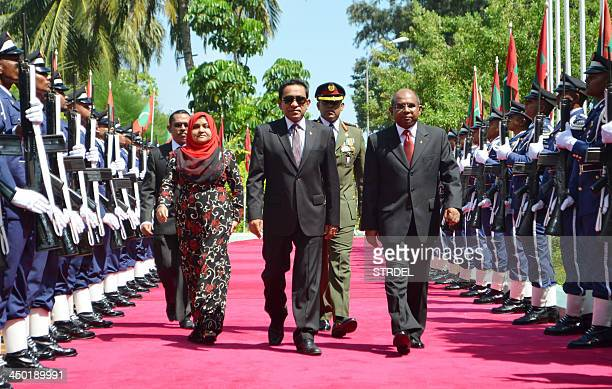 Maldivian President Abdulla Yameen walks during a swearing in ceremony in Male on November 17 after winning second round elections a day earlier...