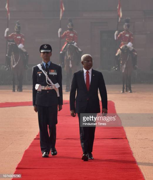 Maldivian President Ibrahim Mohamed Solih inspects a guard of honour during his ceremonial reception at Rashtrapati Bhawan on December 17 2018 in New...