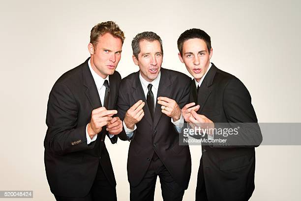 male a capella trio in suits singing and snapping - performance group stock pictures, royalty-free photos & images