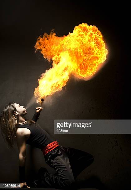 Male Acrobat Blowing Fire