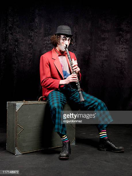 male actor playing clarinet - mime stock photos and pictures