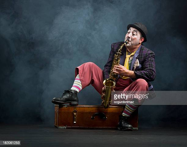 Male actor playing saxophone