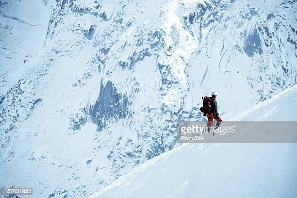 Male Adventurer Walking On Snow Mountain - XLarge