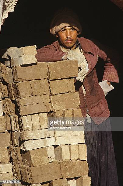Male Afghan refugee seen in a brick factory near Golshahr neighborhod in Mashhad, Iran on 23rd May, 1988. Due to concentration of Afghan refugees in...