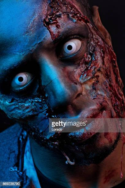 Male African Zombie Alone wearing ruined clothes