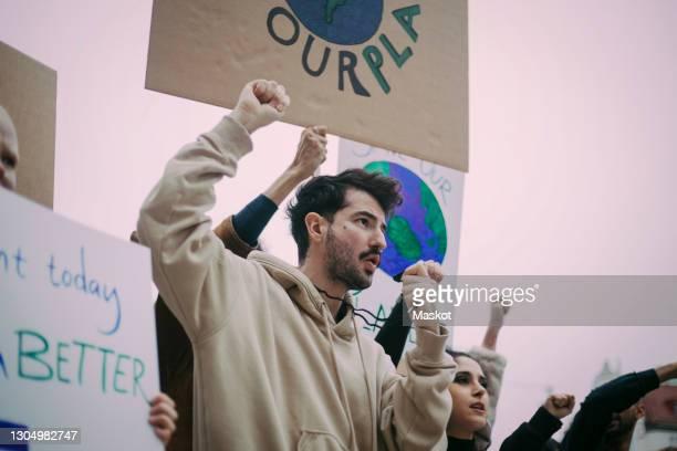 male and female activist during social movement - activista fotografías e imágenes de stock