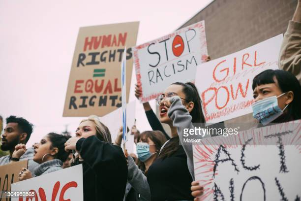 male and female activists protesting for human rights in social movement - civil rights stock pictures, royalty-free photos & images